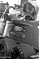 Jody Scheckter speaks with Derek Gardner, designer of the Tyrrell P34 six-wheel Formula 1 car, during practice for the 1976 Grand Prix of Sweden at Anderstorp.