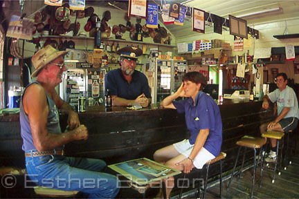 Group of regular pub customers inside Royal Mail Hotel. Hungerford Gate in Dingo Fence. Queensland border.