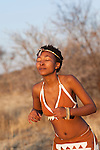 A young Tswana woman performing a traditional dance.