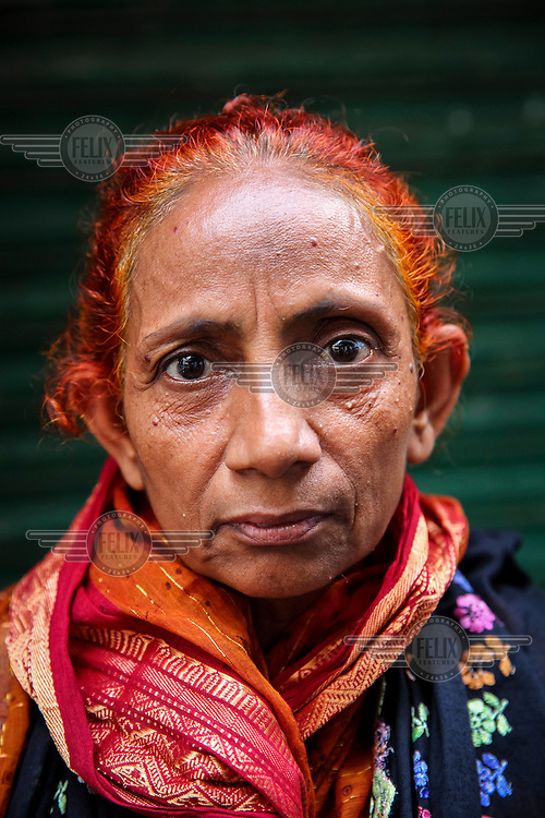 Ameena Begum.<br /> <br /> It is very common in Bangladesh to see older people with dyed orange hair, men with orange beards or orange moustaches and women with orange hair. The dye used is from the flowering Henna plant. The practice comes from the widely held belief that the Prophet Muhammad dyed his beard and hair. It is also common among people returning from Hajj. Some Muslims believe that henna is the only dye they are free to use for colouring their hair.