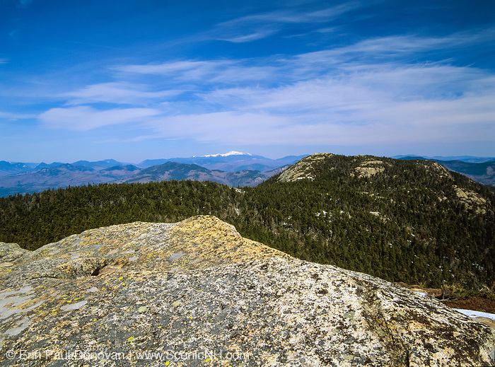Scenic views of Three Sisters from Mount Chocorua which is in the White Mountain National Forest. The Presidential Range is snow capped off in the distance. Located in the White Mountains, New Hampshire USA