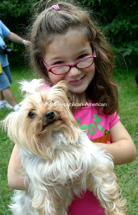 BETHLEHEM, CT, 16 SEPTEMBER 2006, 091606BZ10- Kailey Gelada, of Naugatuck, holds &quot;Maggie&quot; her Yorkshire Terrier <br /> during the fifth annual Bellamy-Ferriday House Dog Show Saturday afternoon.<br />  Jamison C. Bazinet Republican-American