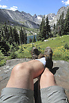 Hiker rests above Isabelle Lake in the Indian Peaks Wilderness Area, west of Boulder, Colorado.