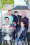 Aidan O'Mahony who presented his football boots to an anonymous kid in the crowd who captured his heart with his smile after the All Ireland final met up with  Diarmuid de Bhillis and his dad Dick at Home from Home Fossa on Thursday where he brought the Sam Maguire also in picture is Helena Fox manager and Mick Leahy
