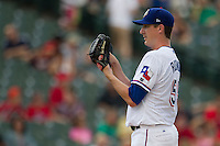 Round Rock Express pitcher Scott Richmond (55) looks to his catcher for the sign during the Pacific Coast League baseball game against the New Orleans Zephyrs on June 30, 2013 at the Dell Diamond in Round Rock, Texas. Round Rock defeated New Orleans 5-1. (Andrew Woolley/Four Seam Images)