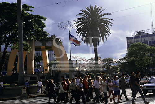 San Jose, Costa Rica. People crossing the road on a pedestrian crossing in front of the kiosk in the Parque Central.