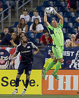 New England Revolution goalkeeper Matt Reis (1) stretches to grab a long pass. In a Major League Soccer (MLS) match, the New England Revolution tied Houston Dynamo, 1-1, at Gillette Stadium on August 17, 2011.
