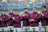 England players engage in a minute's applause in memory of Australian cricketer Phillip Hughes prior to the match. QBE International match between England and Australia on November 29, 2014 at Twickenham Stadium in London, England. Photo by: Patrick Khachfe / Onside Images