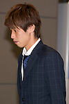 """Japan national football team, Yuya Osako, June 27, 2014, Chiba, Japan - Yuya Osako arrives at Narita International Airport with other members of the Japan national football team. Members of the Japan national football team arrives at Narita with a disappointed look on their faces. They couldn't advance to the final 16 in """"2014 FIFA World Cup Brazil"""" and came back earlier. (Photo by Rodrigo Reyes Marin/AFLO)"""