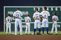 A group of youth baseball players join Durham Bulls outfielders Desmond Jennings (13), Boog Powell (2) and Joey Rickard (4) on the field for the National Anthem prior to the game against the Indianapolis Indians at Durham Bulls Athletic Park on August 4, 2015 in Durham, North Carolina.  The Indians defeated the Bulls 5-1.  (Brian Westerholt/Four Seam Images)