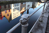 BRUGES, BELGIUM - FEBRUARY 06 : A detail of a railing along a canal with the reflection of the typical flemish facades with stepped gable roofs on February 06, 2009 in Bruges, Western Flanders, Belgium. (Photo by Manuel Cohen)