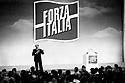 Sivio Berlusconi, leader of Forza Italia (political party), speaks at Forza Italia national convention in Assago, Milan, March 13, 1994...Silvio Berlusconi, leader di Forza Italia, parla al Convegno Nazionale del nuovo partito ad Assago, 13 marzo 1994.