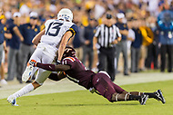Landover, MD - SEPT 3, 2017: Virginia Tech Hokies safety Reggie Floyd (21) tackeles West Virginia Mountaineers wide receiver David Sills V (13) after a short gain during game between West Virginia and Virginia Tech at FedEx Field in Landover, MD. (Photo by Phil Peters/Media Images International)