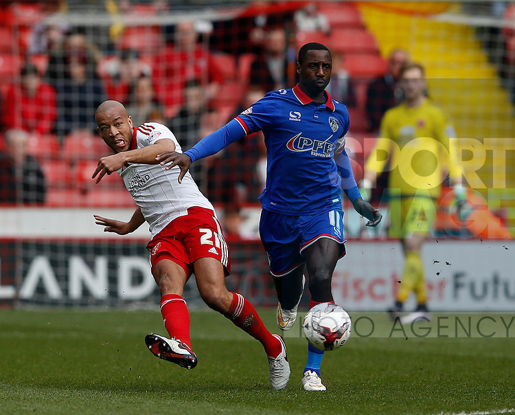 Alex Baptiste of Sheffield Utd clears under pressure from Jonathan Forte of Oldham Athletic during the Sky Bet League One match at The Bramall Lane Stadium.  Photo credit should read: Simon Bellis/Sportimage