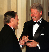 Washington, DC - September 29, 1999 -- U.S. President Bill Clinton welcomes Jim Lehrer, one of the recipients of the 1999 National Humanities Medal to the White House in Washington, DC on 29 September, 1999..Credit: Ron Sachs / Pool via CNP