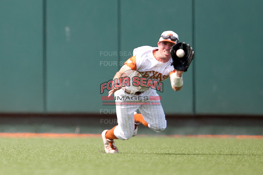 Texas Longhorns outfielder Tim Maitland #9 makes a catch during the NCAA baseball game against the Texas A&M Aggies on April 28, 2012 at UFCU Disch-Falk Field in Austin, Texas. The Aggies beat the Longhorns 12-4. (Andrew Woolley / Four Seam Images)