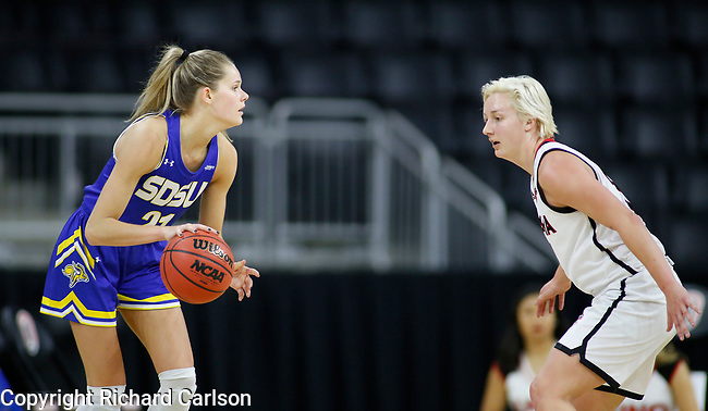 December 29, 2019; Omaha, NE, USA; Tylee Irwin works against an Omaha defender in Summit League women's basketball Sunday at Baxter Arena in Omaha, NE. (Photo by Richard Carlson)