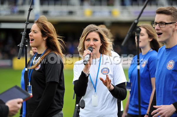 A Choir perform on the pitch at half-time. Aviva Premiership match, between Bath Rugby and Exeter Chiefs on October 17, 2015 at the Recreation Ground in Bath, England. Photo by: Patrick Khachfe / Onside Images