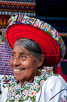 Lago Atitlan, Guatemala, March 2012. A maya woman poses for money in the tourist town of Santiago Atitlan.  Laguna de Atitlán, Lake Atitlan, is a beautiful volcanic lake in the Western Highlands of Guatemala. It is ringed by small towns, many of which are favourites among backpackers. The region encompasses the lake and the towns around them. Panajachel is best known, and a good entry point Guatemala is a great country to experiencce the Mayan lifestyle and see the ruins of ancient cultures. Photo by Frits Meyst/Adventure4ever.com