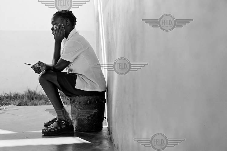 An orphan child in a day-care centre in Maputo, Mozambique on February 23, 2001. More than 13 million African children have been orphaned by the AIDS pandemic. Worldwide, more than 20 million people have died since 1981.