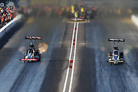 Feb. 23, 2013; Chandler, AZ, USA; NHRA top fuel dragster driver Steve Torrence (left) races alongside Brittany Force during qualifying for the Arizona Nationals at Firebird International Raceway. Mandatory Credit: Mark J. Rebilas-