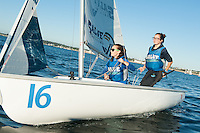 Salve's Crete Clifford, crew, left, and Stephanie Clancy,'17, captain, sail together during practice in the Newport Harbor.