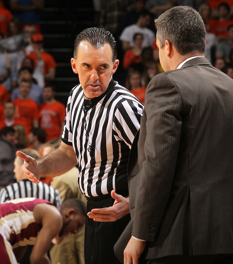 A referee talks with Virginia Cavaliers head coach Tony Bennett during the game against Florida State in Charlottesville, Va.  Florida State defeated Virginia 63-60.
