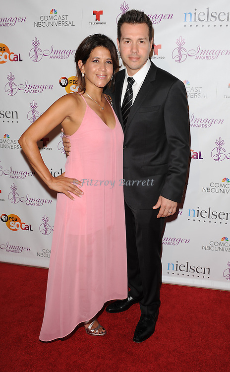 Jon Seda and Lisa Gomez arriving at the Imagen Awards 2014 held at The Beverly Hilton Hotel Beverly Hills, Ca. August 1, 2014.