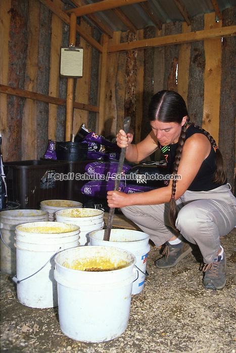 Susan Butcher Mixes Dog Food For Dogs Summer Eureka Ak