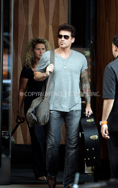 WWW.ACEPIXS.COM . . . . .  ....July 15 2011, New York City....Country singer Billy Ray Cyrus outside his hotel in Soho on July 15 2011 in New York City....Please byline: CURTIS MEANS - ACE PICTURES.... *** ***..Ace Pictures, Inc:  ..Philip Vaughan (212) 243-8787 or (646) 679 0430..e-mail: info@acepixs.com..web: http://www.acepixs.com