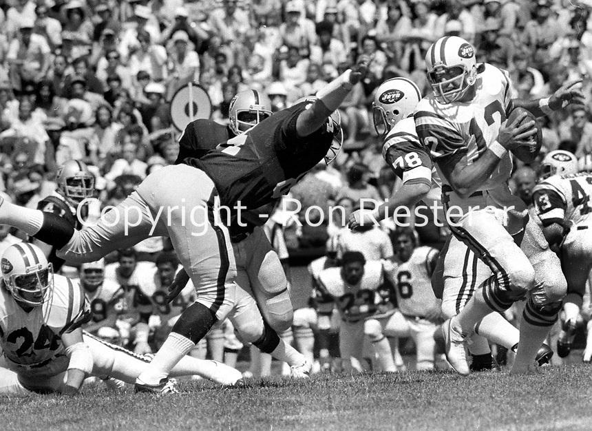 Oakland Raiders DE Tony Cline after New York QB Joe Namath...(1973 photo/Ron Riesterer)