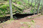 Cow Cave along the Bearcamp River Trail in Sandwich, New Hampshire during the summer months. Legend has it that a cow wandered away from a farm and spent a winter in this cave.