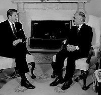 Washington, DC., USA, February 13,1984<br /> President Ronald Reagan meets with King Hussein II of Jordan in the Oval Office of the White House. Credit: Mark Reinstein/MediaPunch