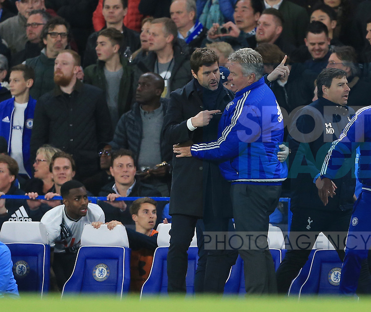 Chelsea's Guss Hiddink chats with Tottenham's Mauricio Pochettino during the Barclays Premier League match at Stamford Bridge Stadium.  Photo credit should read: David Klein/Sportimage
