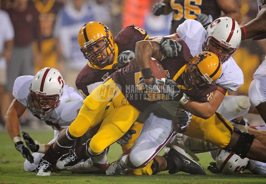 Sept 6, 2008; Tempe, AZ, USA; Arizona State University Sun Devils tailback (24) Keegan Herring is tackled by Stanford Cardinal defensive tackle (98) Levirt Griffin in the first half at Sun Devil Stadium. Mandatory Credit: Mark J. Rebilas-