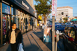A man passes in front of the American Apparel store located on Sunset Boulevard in the Echo Park neighborhood of Los Angeles, California February 6, 2015.