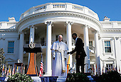 U.S. President Barack Obama (R) welcomes Pope Francis (L) during an arrival ceremony at the White House on September 23, 2015 in Washington, DC. The Pope begins his first trip to the United States at the White House followed by a visit to St. Matthew's Cathedral, and will then hold a Mass on the grounds of the Basilica of the National Shrine of the Immaculate Conception. <br /> Credit: Win McNamee / Pool via CNP