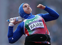 06.08.2012. London England.  Leyla Rajabi of Iran practices with a water bottle during the Shot Put Qualification Round during the London 2012 Olympic Games Athletics, Track and Field events at the Olympic Stadium, London, Britain 06 August 2012.