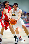 17 January 2010: University of Vermont Catamount forward Evan Fjeld, a Junior from Durham, NC, keeps the ball away from Boston University Terrier forward Brendan Sullivan, a Senior from Darien, CT, at Patrick Gymnasium in Burlington, Vermont. The Catamounts, holding the lead for the entire game, defeated the Terriers 78-58. Mandatory Credit: Ed Wolfstein Photo