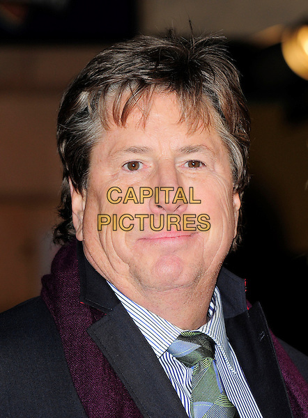 ANDY TENNANT (director).Attending 'The Bounty Hunter' UK film premiere at the Vue West End,cinema Leicester Square, London, England, UK, 11th March 2010 .arrivals portrait headshot purple green blue shirt tie maroon aubergine scarf red print pattern striped .CAP/BEL.©Tom Belcher/Capital Pictures