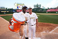 Taylor Trammell (5) of Mt. Paran Christian High School in Powder Springs, Georgia is presented the Gatorade G Award by Andy Ferguson after the Under Armour All-American Game on August 15, 2015 at Wrigley Field in Chicago, Illinois. (Mike Janes/Four Seam Images)