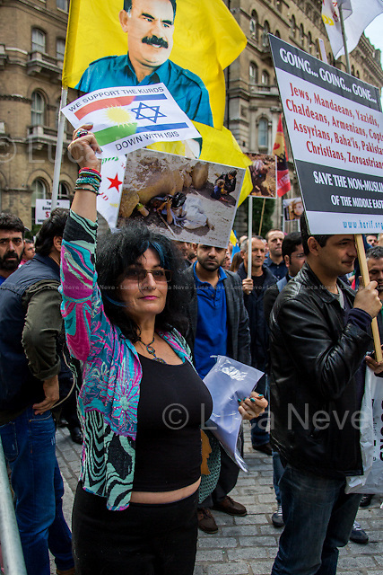 "London, 16/08/2014. Today, ""The Kurdish People's Assembly UK"" held a demonstration in support and solidarity with the people of Sinjar, and its region, recently attacked by the group Islamic State of Iraq and Syria (ISIS). The Campaigner called for the international community not to ignore the ongoing massacre against the Kurdish people and other ethnic and religious groups including members of the Shia, Sufi, Christian and Yezidi communities and to put political pressure against States, such as Turkey, Saudi Arabia and Qatar, allegedly accused of ""supporting jihadism in the region"". The demonstration started outside the BBC HQ in Portland Place and ended outside the US Embassy."