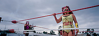 "Diabolica, a ""Luchadora"" (female wrestler) growls at the crowd in Ecatepec, Estado de Mexico. Diabolica is what is known as a wrestler that is ""Ruda"" (these are the badies) as opposed to ""Tecnico"" who are the ones who follow the rules (goodies). Mexico, June 2004"