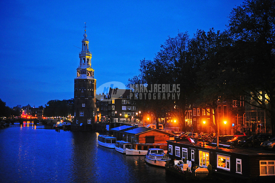 Amsterdam Holland Netherlands apartment water reflection europe city lights urban condo canal boathouse church steeple urban dusk