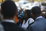 Members of the family of Tyshawn Lee, 9, who was shot multiple times while playing basketball in an alley on November 2, 2015, arrive for the funeral on the steps of St. Sabina's in Chicago, Illinois on November 10, 2015. Police allege the killing was a retaliatory gang hit which would mark a new turn in Chicago's gang wars.