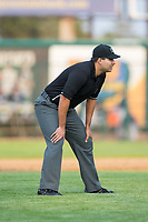 Umpire Edgar Huerta-Morales handles the calls on the bases during the Pioneer League game between the Helena Brewers and the Great Falls Voyagers at Centene Stadium on August 19, 2017 in Helena, Montana.  The Voyagers defeated the Brewers 8-7.  (Brian Westerholt/Four Seam Images)