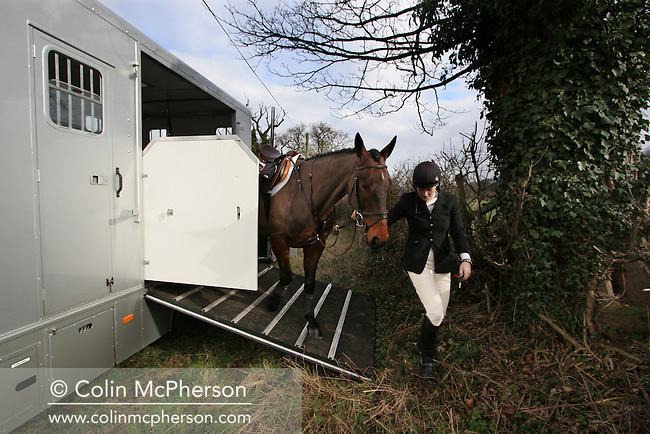 Ruth Moore arrives with her horse Nigel for a day's foxhunting with the Wynnstay Hunt on the last day before the sport was banned. The Wynnstay Hunt, named after Sir Watkin Williams-Wynn, dated back to the 18th century and hunted on country estates in Shropshire, Cheshire and north Wales. Hunting with dogs in England and Wales became illegal on 18th February 2005 despite legal challenges to the ban and many hunts vowed to continue the ancient sport of foxhunting, risking prosecution.