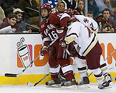 Pat Gannon (Boston College - Arlington, MA) moves in on Steve Mandes (Harvard University - Doylestown, PA) to help a teammate. The Boston College Eagles defeated the Harvard University Crimson 3-1 in the first round of the 2007 Beanpot Tournament on Monday, February 5, 2007, at the TD Banknorth Garden in Boston, Massachusetts.  The first Beanpot Tournament was played in December 1952 with the scheduling moved to the first two Mondays of February in its sixth year.  The tournament is played between Boston College, Boston University, Harvard University and Northeastern University with the first round matchups alternating each year.