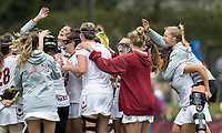 Newton, Massachusetts - April 14, 2018: NCAA Division I. Boston College (white) defeated Virginia Tech (orange), 9-7, at Newton Campus Lacrosse Field.<br /> Victory celebration.