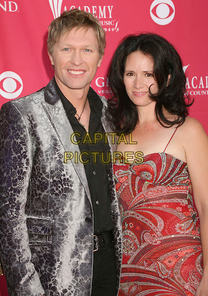 CRAIG MORGAN & WIFE.42nd Annual Academy Of Country Music Awards held at the MGM Grand Garden Arena, Las Vegas, Nevada, USA..May 15th, 2007.half length grey gray floral print jacket red pattern paisley dress married husband .CAP/ADM/BP.©Byron Purvis/AdMedia/Capital Pictures